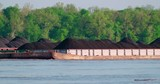Barge carrying coal down the Mississippi river by boat - 245042953