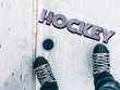 hockey puck and stick on the ice texture, copyspace and text b