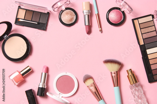 professional makeup tools. Makeup products on a colored background top view. A set of various products for makeup. - 245137709