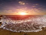Fototapeta Zachód słońca - majestic sunset over sea shore © Pavel Klimenko