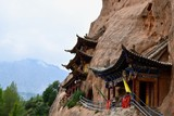 Hanging Mati Si temple with mountains and cloudy sky in the background in Gansu province, China - 245147565