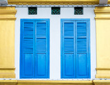 Beautiful facade detail with bright blue shutters on white and golden wall in Little India, Singapore - 245150151