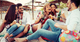 Friends partying and having fun on beach at summer - 245152176