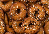 Close view of bite size bagel chips with seeds - 245170380