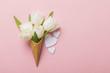 Leinwandbild Motiv Flat-lay waffle cone with white flower blossom