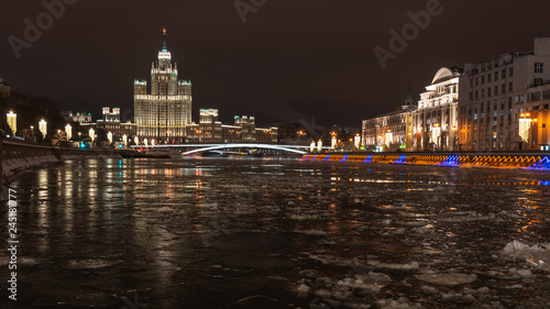 Modern buildings in the illumination on the background of the night river