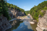 Fototapeta Nowy Jork - The Slow Moving Calm Waters of Summer on the Genesee River in New York's Letchworth State Park © Matt