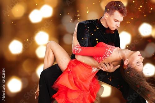 Leinwandbild Motiv Man and a woman dancing Salsa on background