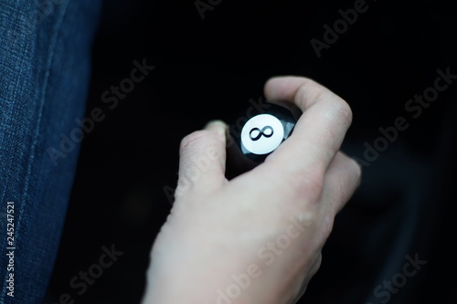 Eightball eight ball gear shift knob inside a car, ready for a race - 245247521