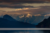 Fototapeta Zachód słońca - Harrison Lake is the largest lake in the southern Coast Mountains of Canada. The view from the lakefront is dominated by Breckenridge Glacier in the distance and by Echo Island. Lake Harrison, British © LoweStock