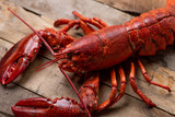 whole lobster on wood table
