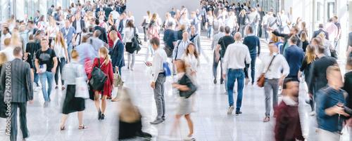 Leinwanddruck Bild large crowd of anonymous blurred people