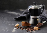 still life of coffee, grains and ground on a black background - 245275178