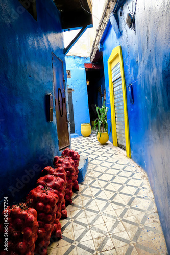 narrow street in fes morocco old town, photo as background © underworld
