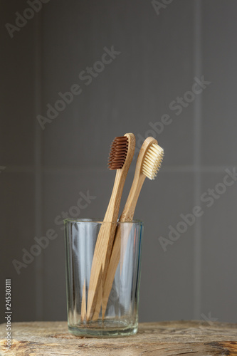 Two eco friendly bamboo brushes in a glass