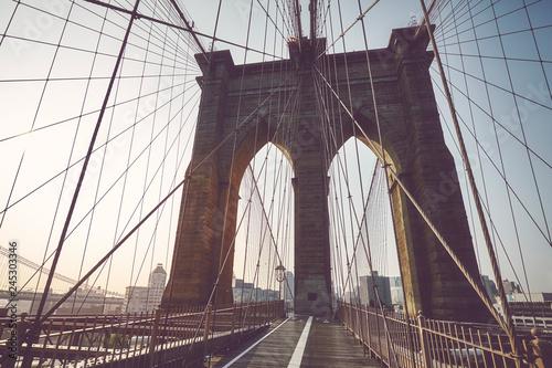 fototapeta na ścianę Brooklyn Bridge at sunrise, color toned picture, NYC.