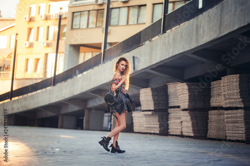 fototapeta na ścianę beautiful sexy woman in a short skirt walking in the city