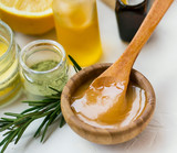Organic skincare ingredients with manuka honey, oils, clay and rosemary herb, honey closeup