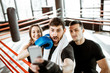 Friends making selfie portrait, having fun together during the sports break after the training on the boxing ring at the gym