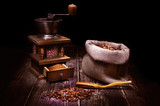 Still life with an old coffee grinder on a wooden table.  - 245391176