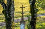 Old single grave monument with christian cross in Bieszczady mountains in Poland