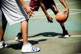 Detail of two men playing basketball on outdoor court - 245442318
