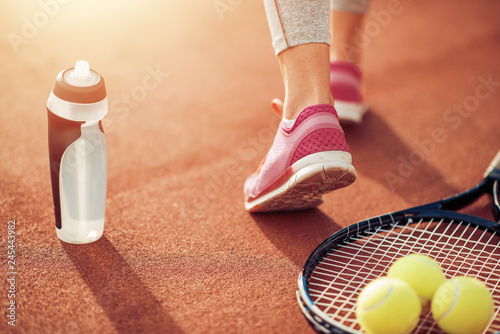 Close up view of tennis racket and balls on the court