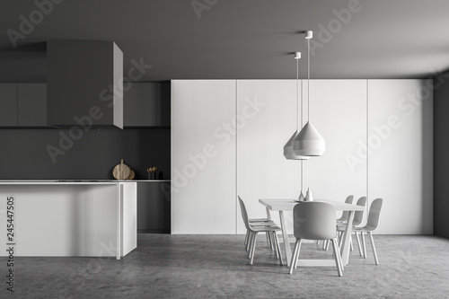 Gray and white kitchen with table - 245447505