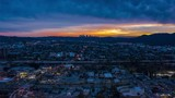 4K Cinematic Urban Aerial Timelapse in motion ( hyperlapse ) of Los Angeles at beautiful sunset
