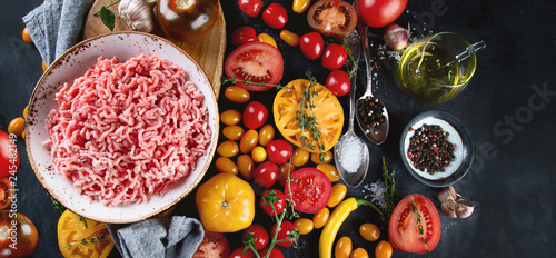 Ingredients for cooking - minced meat, tomatoes and spices. - 245482149