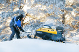 Man With Stuck Snowmobile. Sunrise, sunset winter day. Winter fun for man. - 245497193