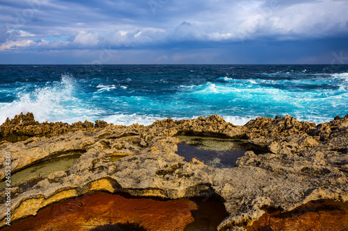 emerald mediterranean sea bay with rocky coast at the storm - 245534388
