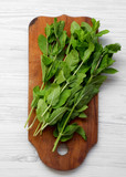 Fresh mint on rustic wooden board over white wooden surface, top view. Flat lay, overhead, from above. - 245547337