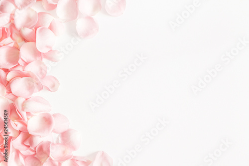 Foto Murales Flowers composition. Rose flower petals on white background. Valentines day, mothers day, womens day concept. Flat lay, top view, copy space