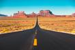 Leinwandbild Motiv Long road in Monument Valley at sunset, USA