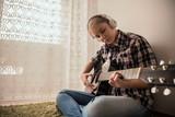 Teenager  plays guitar