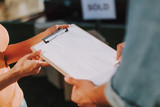 Close up of a folder in hands of a real estate agent - 245640185