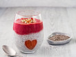 Leinwanddruck Bild - Idea for healthy breakfast on Valentine's Day: Chia pudding with red berry puree, chopped almonds on top and strawberry in the shape of heart. Copy space for text