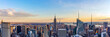 New York City skyline from roof top with urban skyscrapers at sunset. New York, USA. Panorama image.