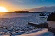 Winter sun sets over frozen ocean bay NL Canada