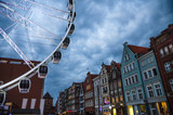 Big ferris wheel, buildings and tower Brama Stagiewna, Gdansk, Poland