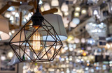 Lamp of style of the loft in an interior of shop. A stylish lamp in a metal framework. - 245718360