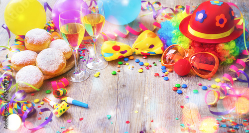 Colorful carnival or party background with donuts, balloons, streamers and confetti and funny face - 245747189