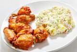 Crispy chicken wings and potato salad - 245747399