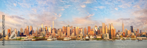 New York City Manhattan skyline panorama at sunset over Hudson River