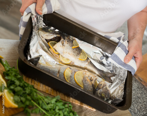 Baked with lemon dorado fish - 245770157