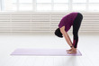 Yoga, people concept - a middle-aged woman doing a yoga in the gym
