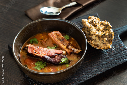 meat soup with bread - 245776718