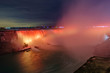 Scenic view of Horseshoe Falls on Niagara river illuminated by orange nighttime illumination in Canada. Beautiful depressive winter look of largest cascade of famous Niagara falls