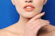 Leinwandbild Motiv Young woman wearing beautiful lipstick on color background, closeup